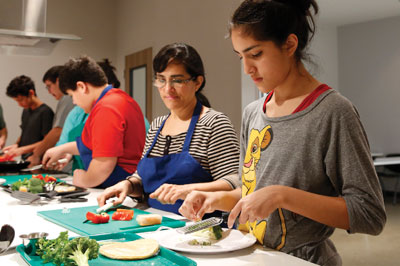 Youth learn cooking skills at Mays YMCA.